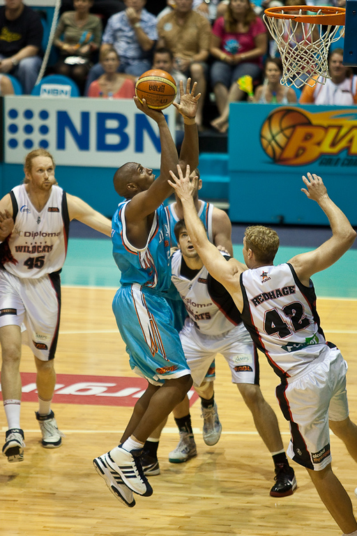 Erron Maxey shoots under the close watch of Shawn Redhage - Gold Coast Blaze v Perth Wildcats NBL Basketball; 5 February 2010.