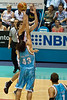 Stephen Weigh shoots over Chris Goulding - Gold Coast Blaze v Perth Wildcats NBL Basketball; 5 February 2010.