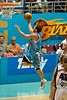Adam Gibson lays-up against the Wildcats. Defender Kevin Lisch had gone under the Blaze' screen and Gibson still managed to do exactly what Lisch  was trying to prevent... - Gold Coast Blaze v Perth Wildcats NBL Basketball; 5 February 2010.