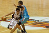 Tyson Demos about to take the charge against Damian Martin - Gold Coast Blaze v Perth Wildcats NBL Basketball; 5 February 2010.