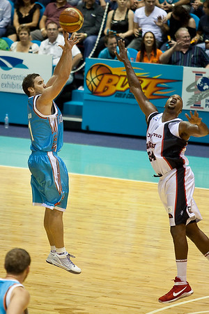 Perth Wildcat seems to 'look to the skies for help' as he defends Adam Gibson shooting the 3 pointer. - Gold Coast Blaze v Perth Wildcats NBL Basketball; 5 February 2010.