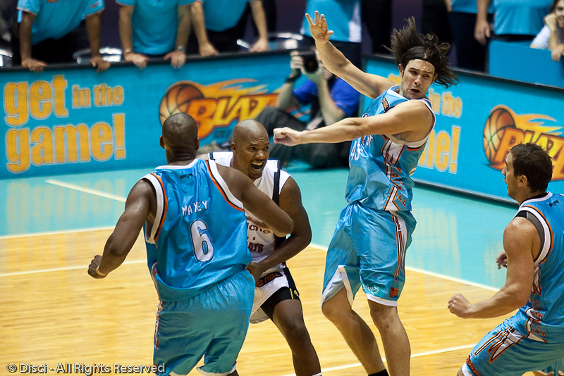 Chris Goulding looks concerned about the bump he has received from Galen Young - Gold Coast Blaze v Perth Wildcats Semi-final G2, 23 February 2010. After being down for most of the game, the Wildcats came back in the final minutes to score an 82-78 win. Wildcat import Kevin Lisch scored 11 of his 18 points in the final five minutes to help his team to the win.