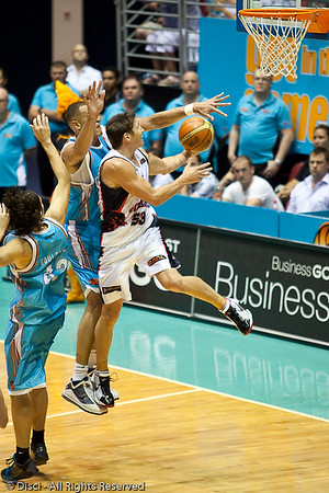 Damian Martin drives past Craig Bradshaw for the deuce - Gold Coast Blaze v Perth Wildcats Semi-final G2, 23 February 2010. After being down for most of the game, the Wildcats came back in the final minutes to score an 82-78 win. Wildcat import Kevin Lisch scored 11 of his 18 points in the final five minutes to help his team to the win.