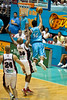 Mika Vukona drives past Galen Young for the spectacular leaning basket - Gold Coast Blaze v Perth Wildcats Semi-final G2, 23 February 2010. After being down for most of the game, the Wildcats came back in the final minutes to score an 82-78 win. Wildcat import Kevin Lisch scored 11 of his 18 points in the final five minutes to help his team to the win.