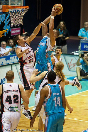 Craig Bradshaw shoots over Damian Martin - Gold Coast Blaze v Perth Wildcats Semi-final G2, 23 February 2010. After being down for most of the game, the Wildcats came back in the final minutes to score an 82-78 win. Wildcat import Kevin Lisch scored 11 of his 18 points in the final five minutes to help his team to the win.