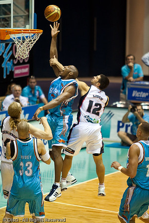 Erron Maxey is fouled by Kevin Lisch - Gold Coast Blaze v Perth Wildcats Semi-final G2, 23 February 2010. After being down for most of the game, the Wildcats came back in the final minutes to score an 82-78 win. Wildcat import Kevin Lisch scored 11 of his 18 points in the final five minutes to help his team to the win.