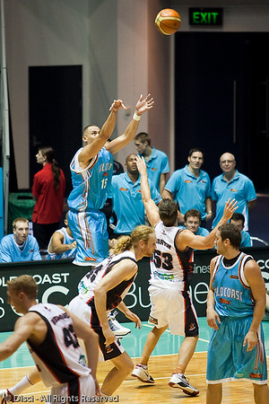 Craig Bradshaw takes the outside shot against Damian Martin - Gold Coast Blaze v Perth Wildcats Semi-final G2, 23 February 2010. After being down for most of the game, the Wildcats came back in the final minutes to score an 82-78 win. Wildcat import Kevin Lisch scored 11 of his 18 points in the final five minutes to help his team to the win.