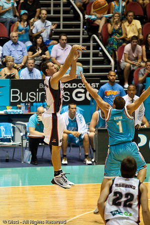 Veteran Martin Cattalini shoots the 3 over Adam Gibson - Gold Coast Blaze v Perth Wildcats Semi-final G2, 23 February 2010. After being down for most of the game, the Wildcats came back in the final minutes to score an 82-78 win. Wildcat import Kevin Lisch scored 11 of his 18 points in the final five minutes to help his team to the win.