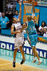 James Harvwey goes strong to the hoop against Damian Martin - Gold Coast Blaze v Perth Wildcats Semi-final G2, 23 February 2010. After being down for most of the game, the Wildcats came back in the final minutes to score an 82-78 win. Wildcat import Kevin Lisch scored 11 of his 18 points in the final five minutes to help his team to the win.