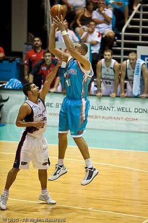 Craig Bradshaw shows his good outside touch against Kevin Lisch - Gold Coast Blaze v Perth Wildcats Semi-final G2, 23 February 2010. After being down for most of the game, the Wildcats came back in the final minutes to score an 82-78 win. Wildcat import Kevin Lisch scored 11 of his 18 points in the final five minutes to help his team to the win.