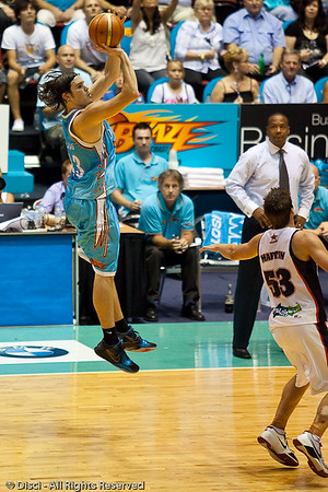 Chris Goulding elevates over Daminan Martin for the deep 3 point shot - Gold Coast Blaze v Perth Wildcats Semi-final G2, 23 February 2010. After being down for most of the game, the Wildcats came back in the final minutes to score an 82-78 win. Wildcat import Kevin Lisch scored 11 of his 18 points in the final five minutes to help his team to the win.