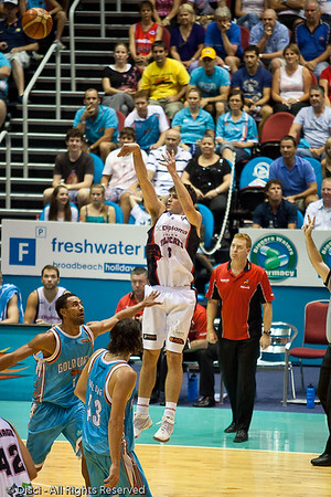 Stephen Weigh does not appear to weigh much as he elevates over Mika Vukona to shoot - Gold Coast Blaze v Perth Wildcats Semi-final G2, 23 February 2010. After being down for most of the game, the Wildcats came back in the final minutes to score an 82-78 win. Wildcat import Kevin Lisch scored 11 of his 18 points in the final five minutes to help his team to the win.