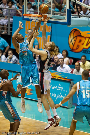 Mika Vukona tries gallantly to stop Luke Schenscher's shot from going in - Gold Coast Blaze v Perth Wildcats Semi-final G2, 23 February 2010. After being down for most of the game, the Wildcats came back in the final minutes to score an 82-78 win. Wildcat import Kevin Lisch scored 11 of his 18 points in the final five minutes to help his team to the win.