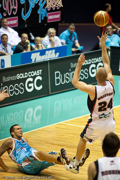 Tyson Demos takes the charge against Jesse Wagstaff - Gold Coast Blaze v Perth Wildcats Semi-final G2, 23 February 2010. After being down for most of the game, the Wildcats came back in the final minutes to score an 82-78 win. Wildcat import Kevin Lisch scored 11 of his 18 points in the final five minutes to help his team to the win.