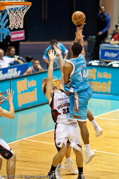 Mika Vukona elevates over Brad Robbins as he is fouled by a second Wildcat -  Gold Coast Blaze v Perth Wildcats Semi-final G2, 23 February 2010. After being down for most of the game, the Wildcats came back in the final minutes to score an 82-78 win. Wildcat import Kevin Lisch scored 11 of his 18 points in the final five minutes to help his team to the win.