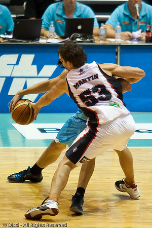 Damian Martin almost gets the steal from Chris Goulding - Gold Coast Blaze v Perth Wildcats Semi-final G2, 23 February 2010. After being down for most of the game, the Wildcats came back in the final minutes to score an 82-78 win. Wildcat import Kevin Lisch scored 11 of his 18 points in the final five minutes to help his team to the win.
