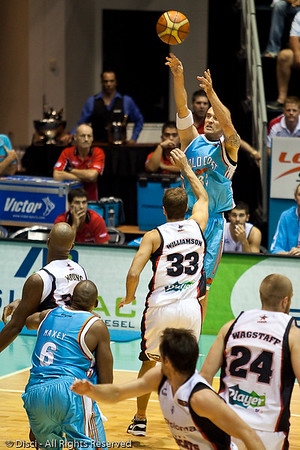 James Harvey shoots from the corner over Drew Williamson. - Gold Coast Blaze v Perth Wildcats Semi-final G2, 23 February 2010. After being down for most of the game, the Wildcats came back in the final minutes to score an 82-78 win. Wildcat import Kevin Lisch scored 11 of his 18 points in the final five minutes to help his team to the win.
