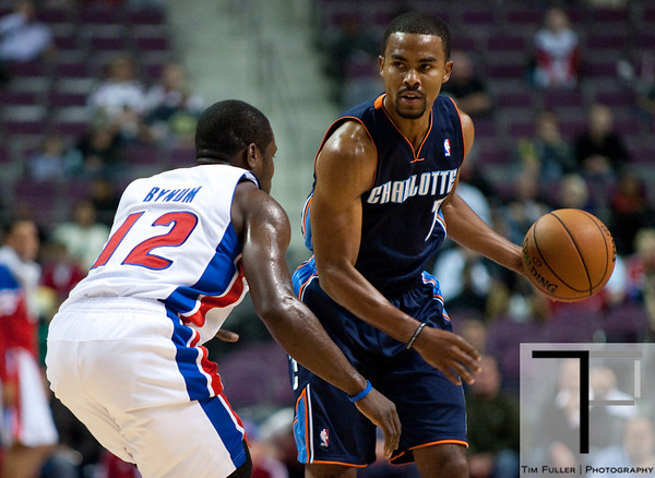 Oct 20, 2012; Auburn Hills, MI, USA; Detroit Pistons point guard Will Bynum (12) guards Charlotte Bobcats point guard Ramon Sessions (7) during the first quarter at The Palace. Mandatory Credit: Tim Fuller-US PRESSWIRE