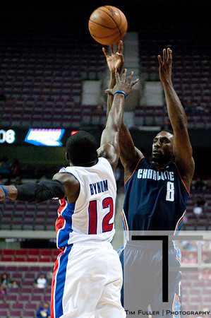 Oct 20, 2012; Auburn Hills, MI, USA; Charlotte Bobcats shooting guard Ben Gordon (8) takes a jump shot over Detroit Pistons point guard Will Bynum (12)during the first quarter at The Palace. Mandatory Credit: Tim Fuller-US PRESSWIRE
