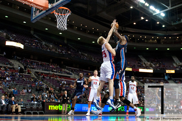 Oct 20, 2012; Auburn Hills, MI, USA; Charlotte Bobcats center Brendan Haywood (33) goes to the basket against Detroit Pistons small forward Kyle Singler (25) during the second quarter at The Palace. Mandatory Credit: Tim Fuller-US PRESSWIRE