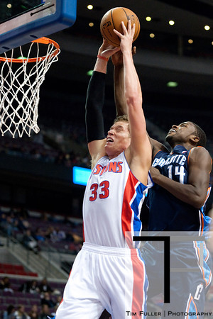 Oct 20, 2012; Auburn Hills, MI, USA; Charlotte Bobcats small forward Michael Kidd-Gilchrist (14) fouls Detroit Pistons power forward Jonas Jerebko (33) during the fourth quarter at The Palace. Detroit won 85-80.  Mandatory Credit: Tim Fuller-US PRESSWIRE