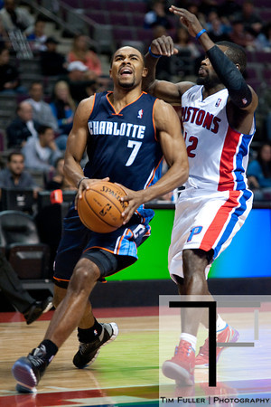 Oct 20, 2012; Auburn Hills, MI, USA; Charlotte Bobcats point guard Ramon Sessions (7) drives to the basket against Detroit Pistons point guard Will Bynum (12) during the first quarter at The Palace. Mandatory Credit: Tim Fuller-US PRESSWIRE