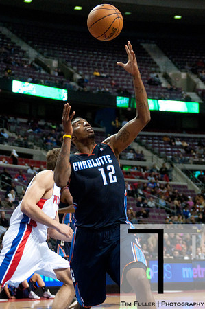 Oct 20, 2012; Auburn Hills, MI, USA; Charlotte Bobcats power forward Tyrus Thomas (12) grads a rebound during the fourth quarter against the Detroit Pistons at The Palace. Detroit won 85-80.  Mandatory Credit: Tim Fuller-US PRESSWIRE