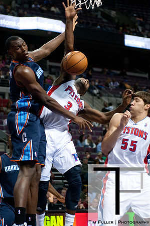 Oct 20, 2012; Auburn Hills, MI, USA; Detroit Pistons point guard Rodney Stuckey (3) loose control of the ball while being pressured by Charlotte Bobcats power forward Bismack Biyombo (0) during the fourth quarter at The Palace. Detroit won 85-80.  Mandatory Credit: Tim Fuller-US PRESSWIRE