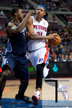 Oct 20, 2012; Auburn Hills, MI, USA; Detroit Pistons power forward Charlie Villanueva (31) drives to the basket against Charlotte Bobcats small forward Michael Kidd-Gilchrist (14) during the fourth quarter at The Palace. Detroit won 85-80.  Mandatory Credit: Tim Fuller-US PRESSWIRE