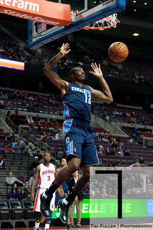 Oct 20, 2012; Auburn Hills, MI, USA; Charlotte Bobcats power forward Tyrus Thomas (12) slam dunks during the first quarter against the Detroit Pistons at The Palace. Mandatory Credit: Tim Fuller-US PRESSWIRE