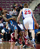 Oct 20, 2012; Auburn Hills, MI, USA; Charlotte Bobcats power forward Tyrus Thomas (left) fouls Detroit Pistons small forward Kyle Singler (25) during the first quarter at The Palace. Mandatory Credit: Tim Fuller-US PRESSWIRE