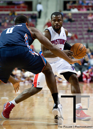 Oct 20, 2012; Auburn Hills, MI, USA; Charlotte Bobcats power forward Bismack Biyombo (0) guards Detroit Pistons point guard Will Bynum (12) during the game at The Palace. Detroit won 85-80.  Mandatory Credit: Tim Fuller-US PRESSWIRE