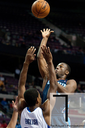 Oct 20, 2012; Auburn Hills, MI, USA; Charlotte Bobcats point guard Kemba Walker (15) drives to the basket while being guarded by Detroit Pistons shooting guard Kim English (24) during the second quarter at The Palace. Mandatory Credit: Tim Fuller-US PRESSWIRE