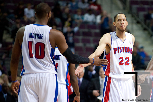 Oct 20, 2012; Auburn Hills, MI, USA; Detroit Pistons small forward Tayshaun Prince (22) high fives center Greg Monroe (10) during the fourth quarter against the Charlotte Bobcats at The Palace. Detroit won 85-80.  Mandatory Credit: Tim Fuller-US PRESSWIRE