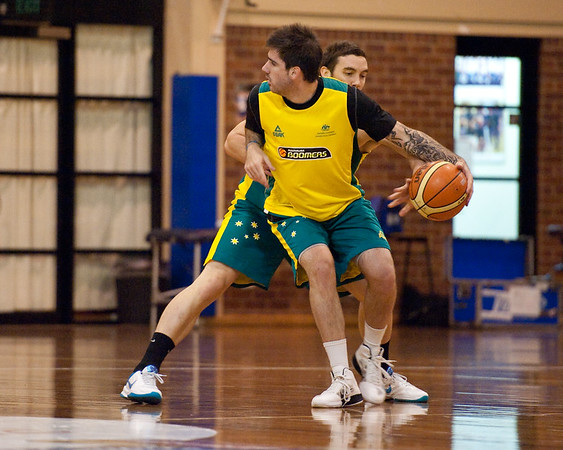 Adam Gibson gets the nice steal from rookie Nate Tomlinson - Boomers - Australian Men's Basketball Team Open Training Session, The Southport School, Queensland, Australia; 28 July 2011. Photos by Des Thureson:  http://disci.smugmug.com.
