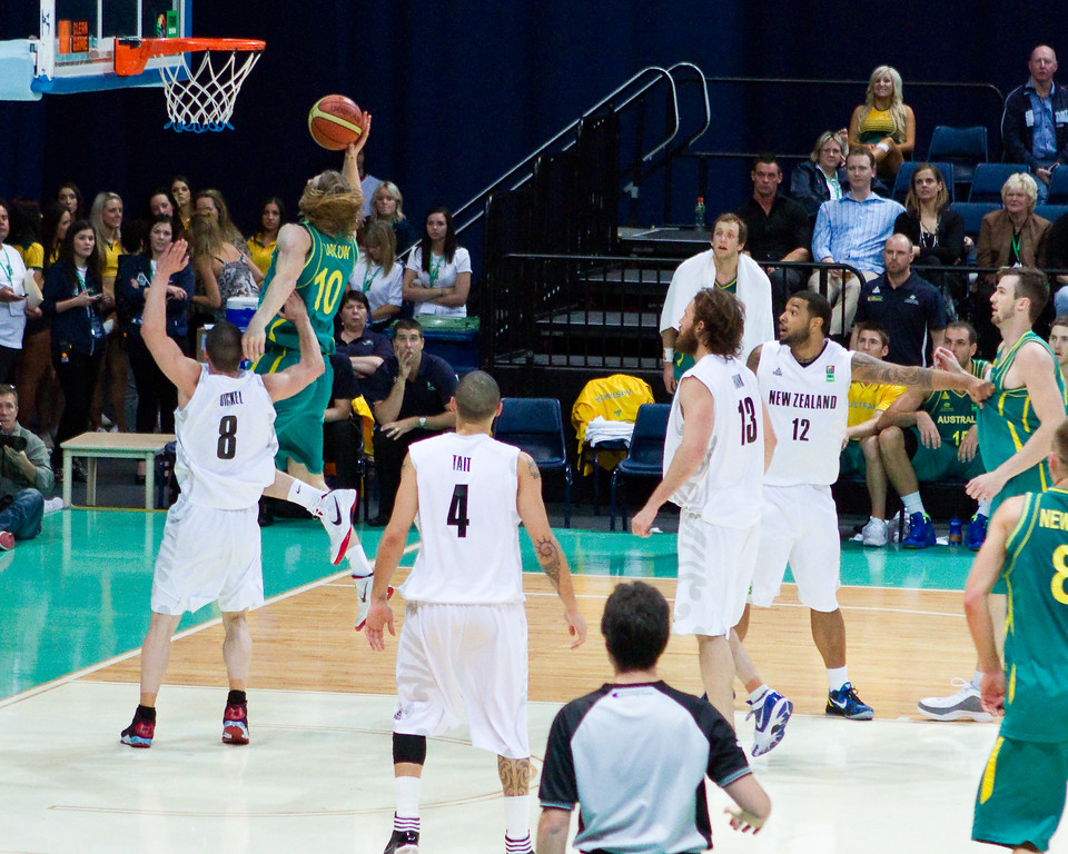 "After receiving a perfect behind-the-back pass from Paty Mills, AJ Ogilvy finishes the fast break with the crowd-pleasing dunk - Australian Boomers v New Zealand Tall Blacks FIBA Oceania Championship International Men's Basketball, Brisbane Entertainment Centre, Boondall, Brisbane, Queensland, Australia; 9 September 2011. Photos by Des Thureson: <a href=""http://disci.smugmug.com"">http://disci.smugmug.com</a>"