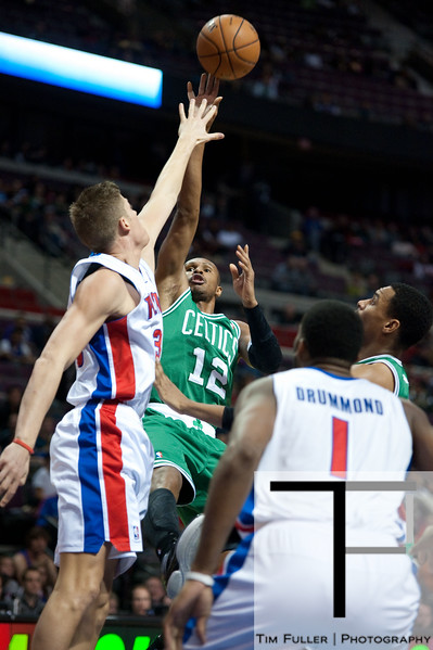 Nov 18, 2012; Auburn Hills, MI, USA; Boston Celtics shooting guard Leandro Barbosa (12) puts up a shot over Detroit Pistons defenders during the second quarter at The Palace. Mandatory Credit: Tim Fuller-US PRESSWIRE