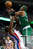 Nov 18, 2012; Auburn Hills, MI, USA; Boston Celtics small forward Paul Pierce (right) fouls Detroit Pistons power forward Jason Maxiell (left) during the first quarter at The Palace. Mandatory Credit: Tim Fuller-US PRESSWIRE