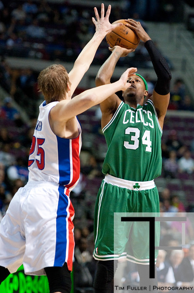 Nov 18, 2012; Auburn Hills, MI, USA; Detroit Pistons small forward Kyle Singler (25) attempts to block Boston Celtics small forward Paul Pierce (34) during the first quarter at The Palace. Mandatory Credit: Tim Fuller-US PRESSWIRE
