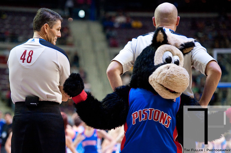 Nov 18, 2012; Auburn Hills, MI, USA; NBA referee Scott Foster (48) watches Detroit Pistons mascot Hooper tease referee Gary Zielinski (top right) during the fourth quarter against the Boston Celtics at The Palace. Detroit won 103-83. Mandatory Credit: Tim Fuller-US PRESSWIRE