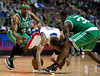 Nov 18, 2012; Auburn Hills, MI, USA; Detroit Pistons point guard Brandon Knight (7) battles for a loose ball against Boston Celtics shooting guard Jason Terry (4) and power forward Brandon Bass (30) during the third quarter at The Palace. Detroit won 103-83. Mandatory Credit: Tim Fuller-US PRESSWIRE