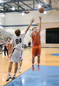 Midd-West's Marshall Dupuy tries to the block the shot from Danville's Matt McConnell during Wednesday night's game.