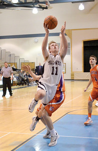 Midd-West's Jon Stemm goes up for a layup during Wednesday's game against Danville.