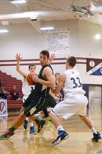 Lewisburg's Sam Allen tries to spin around Shikellamy's Derek Amerman during Saturday's game.
