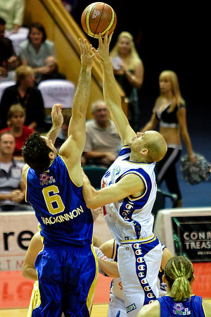 Sam Mackinnon jumps against former Bullet David Cooper - Brisbane Bullets v Adelaide 36ers 4-2-2006