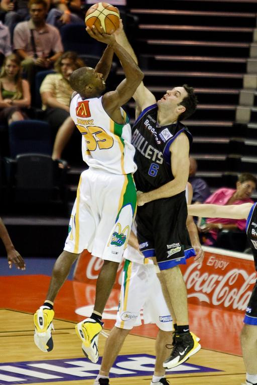 Sam Mackinnon blocks Larry Abney's shot - Brisbane Bullets v Townsville Crocs 23 December 2005