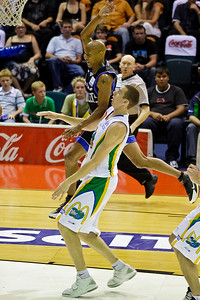 Greg Vanderjagt tries to avoid the contact against Derek Rucker - Brisbane Bullets v Townsville Crocs 23 December 2005