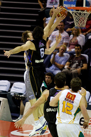 Sam Mackinnon blocks his Boomers team mate Brad Newley