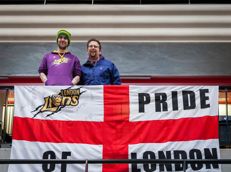 """London Lions fans with """"Pride of London"""" flag at the Copperbox, Olympic Park"""