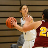 Megan De La Torre looks for an open teammate with Grace Brushi (22) covering her as the Butte College basketball team plays Saturday, Jan. 14, 2017, against College of the Redwoods in Butte Valley, California. (Dan Reidel -- Enterprise-Record)